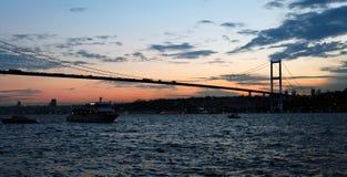 Sundown over bosphorus and Bogazici Kpr Stock Photography