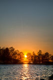 Sundown over an lake Stock Images
