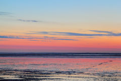 Sundown over mudflat Royalty Free Stock Photo