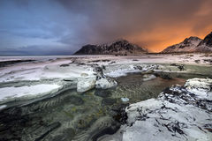 Sundown over Skagsanden Beach in the winter on the Lofoten Islan Royalty Free Stock Photography