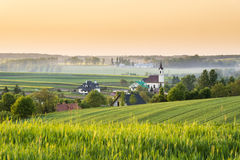 Sundown over village in Poland Stock Image