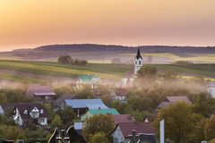 Sundown over village in Poland Stock Photo