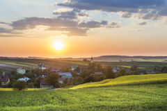 Sundown over village on Polish countryside Royalty Free Stock Photo