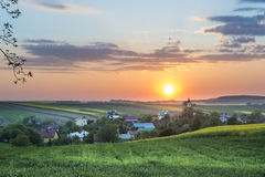 Sundown over village on Polish countryside Royalty Free Stock Photography