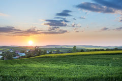 Sundown over village on Polish countryside Stock Photography