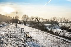 Sundown over walway in winter time Stock Images