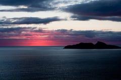Sundown in red. Sundown over the ocean near puffin island Royalty Free Stock Image