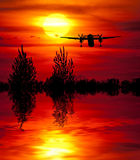 Sundown on the Rhine. Starting airplane with the sun and lake Royalty Free Stock Photos