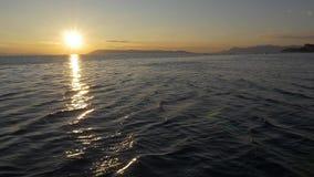 Sundown sailling the sea stock video footage
