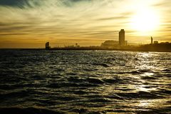 Sundown seascape with Barcelona on the background Stock Photos