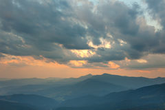 Sundown Sky and Mountains Range Background Stock Photography