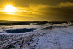 Sundown on a snow covered links golf course Stock Images