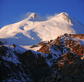 Sundown in snowy mountains Elbrus Royalty Free Stock Image