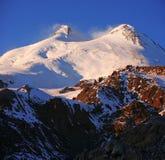 Sundown in snowy mountains Elbrus Royalty Free Stock Image