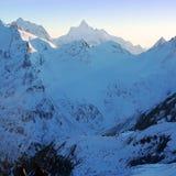 Sundown in snowy mountains Elbrus Stock Photography