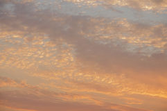 Sundown and sunrises. Orange sky and much clouds. Beautiful bright heaven Royalty Free Stock Images