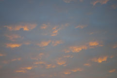 Sundown and sunrises. Orange sky and much clouds. Beautiful bright heaven Stock Photo