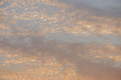 Sundown and sunrises. Orange sky and much clouds. Beautiful bright heaven Royalty Free Stock Image