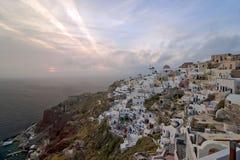 Sundown to clouds in Santorini Stock Photo