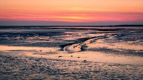 After sundown towards Schiermonnikoog from the ferry leaving for Lauwersoog Royalty Free Stock Photo