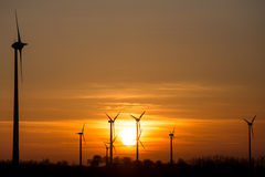 Sundown on a wind farm Royalty Free Stock Photo