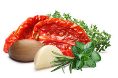 Sundried oiled tomatoes with herbs, paths. Sun-dried tomatoes, oiled, with garlic and fresh herbs. Clipping paths, shadow separated. Design element Royalty Free Stock Photos
