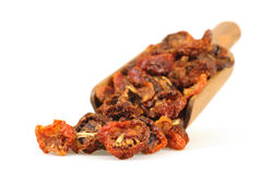 Sundried Tomatoes. Scoop of sundried tomatoes photographed on a white background Royalty Free Stock Photo