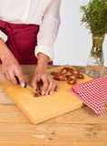 Dried tomatoes being chopped Stock Images