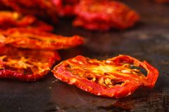 Sundried tomatoes on rustic background Royalty Free Stock Photo