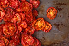 Sundried tomatoes on rustic background Royalty Free Stock Photography
