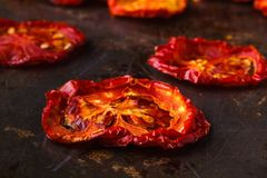 Sundried tomatoes on rustic background Stock Photo