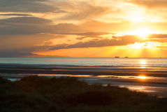 Sunet na praia Imagens de Stock
