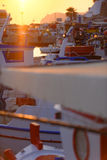 Sunset over boats in harbor stock images