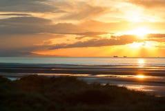 Sunet przy plażą Obrazy Stock