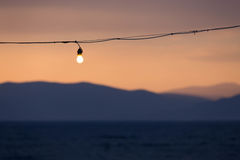 Sunet sky with a lightbulb on a greek island Stock Images