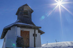Sunflare bak kyrkan Royaltyfri Foto