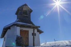 Sunflare derrière l'église Photo libre de droits