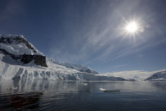 Sunflare in Paradise Bay, Antarctica. royalty free stock photography