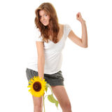Sunflower. Gorgeous teenage female  holding yellow sunflower over white background Stock Photo