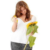 Sunflower. Gorgeous teenage female  holding yellow sunflower over white background Stock Image