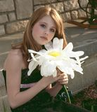 Sunflower. Pretty girl holding a large sunflower Stock Images