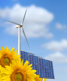 Sunflower, blue solar cells and wind turbine Royalty Free Stock Images