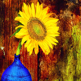 Sunflower on a blue vase with a wooden background Royalty Free Stock Photos