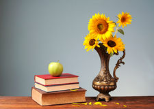 Sunflower and books Stock Image