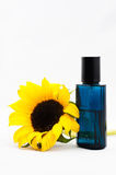 Sunflower and a bottle of perfume. An isolated picture of a sunflower and a bottle of perfume Stock Images