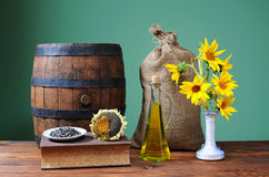 Sunflower in a ceramic vase and wooden barrel Royalty Free Stock Images