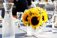 Sunflower on a Dining Table. Sunflowers on a dining table surrounded by fine glass Stock Images
