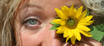 Sunflower eye. Attractive woman with sunflower eye Royalty Free Stock Photo