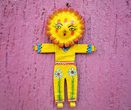 Sunflower figurine on a pink wall Stock Photos