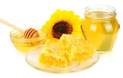 Sunflower with honey isolated on white background. Glass bank of honey. Stock Photo